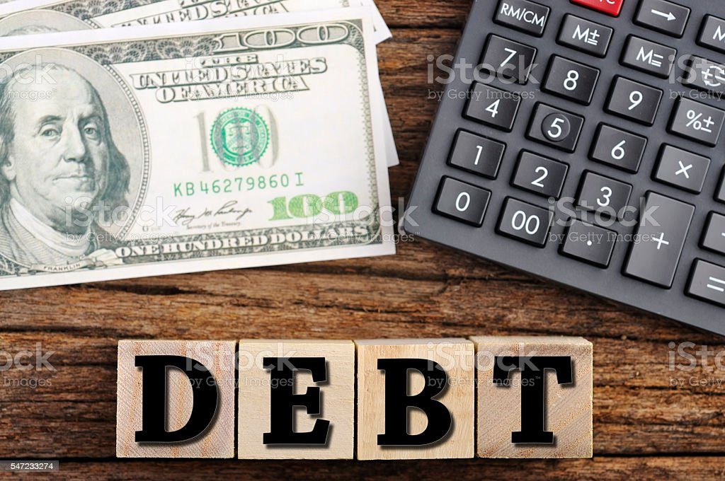 'DEBT' Word on Cube, Finance Concept stock photo
