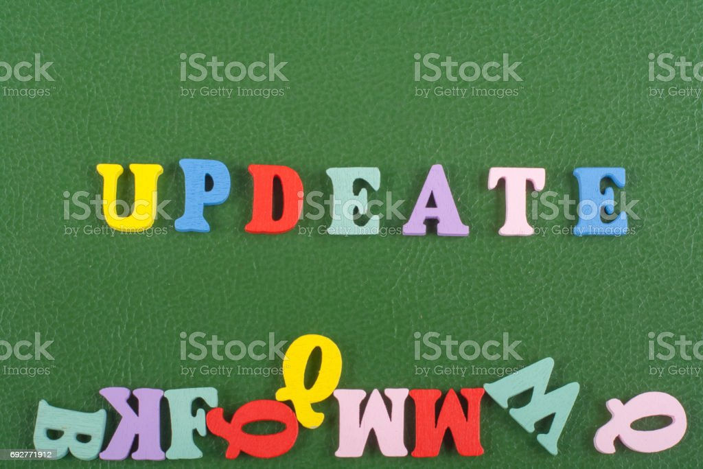 UPDEATE word on green background composed from colorful abc alphabet block wooden letters, copy space for ad text. Learning english concept stock photo