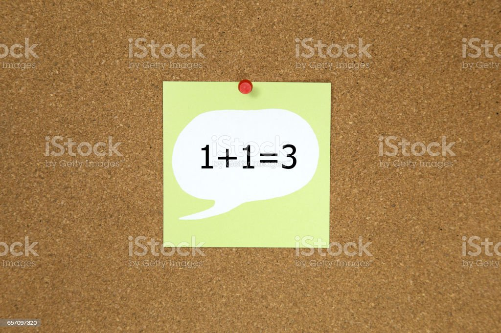 1+1=3 word on sticky note posted to a cork notice board stock photo