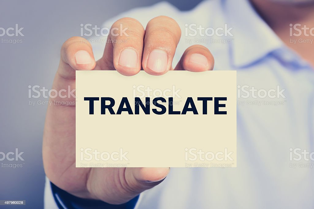 TRANSLATE word on the card held by a man hand stock photo