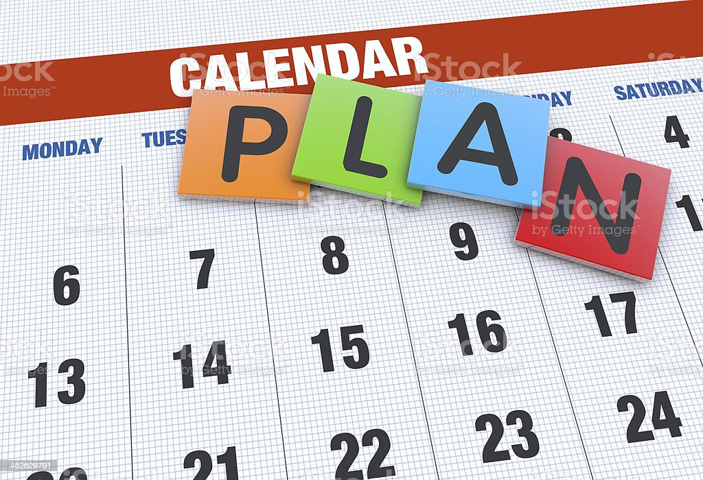 Word plan in different color sqaures on calendar stock photo