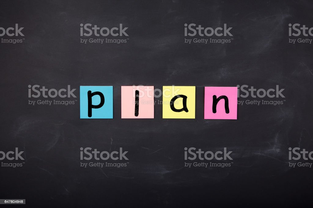 Word 'Plan' written on color stickers on the chalkboard stock photo