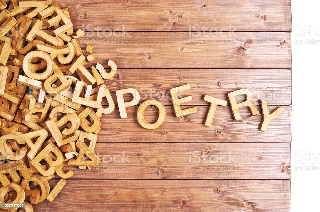 Word poetry made with wooden letters stock photo