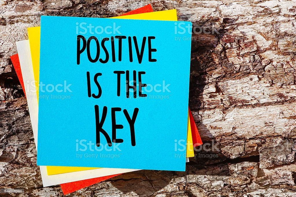 Word quotes of POSITIVE IS THE KEY stock photo