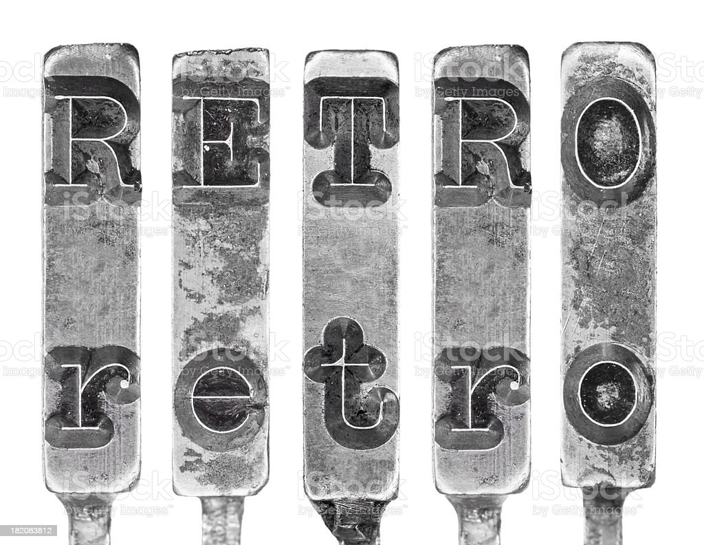 Word RETRO in Old Typewriter Typebar Letters Isolated on White royalty-free stock photo