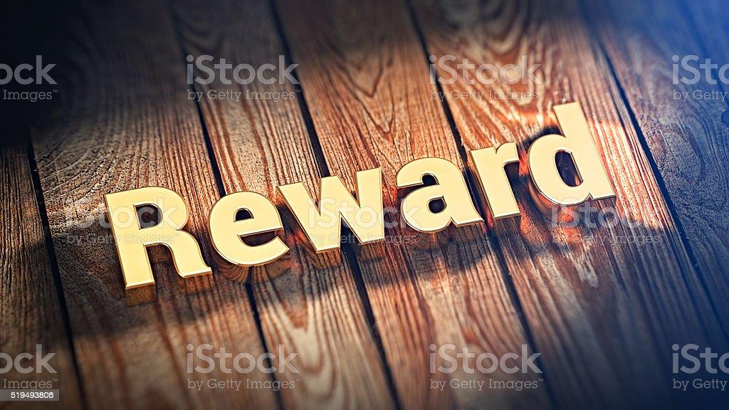 Word Reward on wood planks stock photo