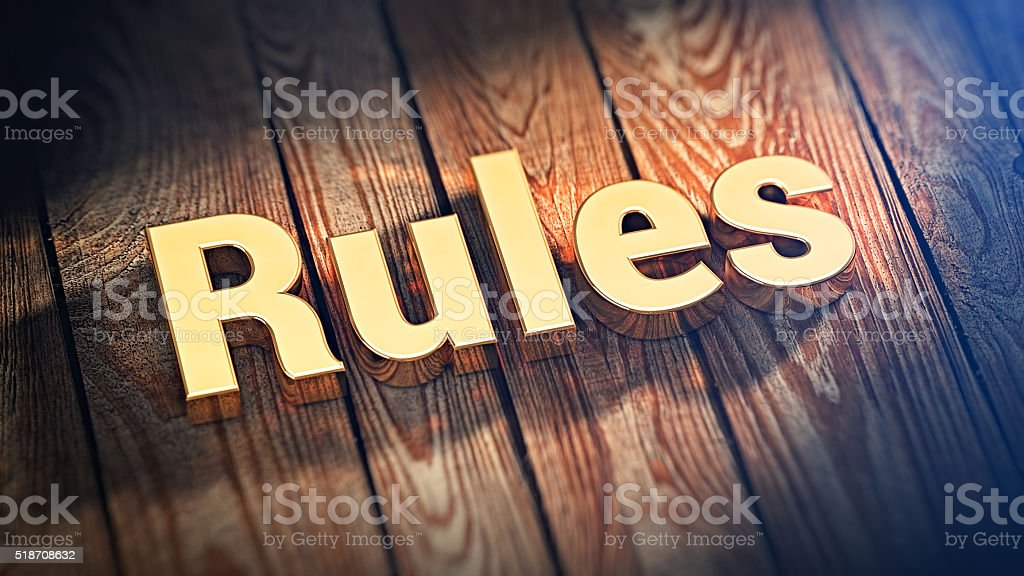 Word Rules on wood planks stock photo