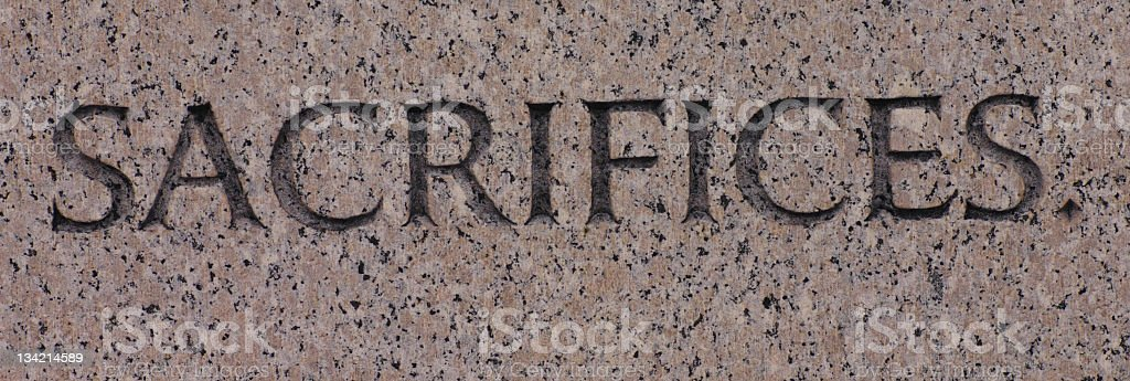 Word Sacrifices Carved in Gray Granite Sacrifice royalty-free stock photo