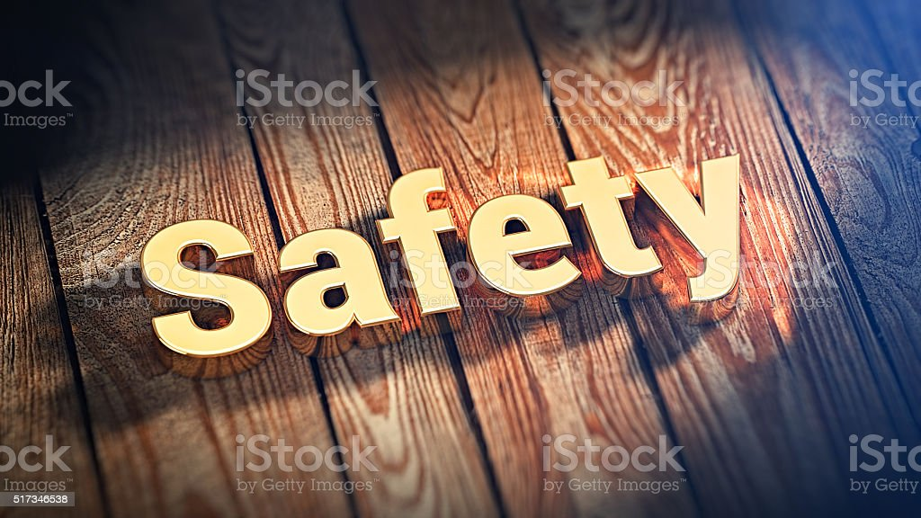 Word Safety on wood planks stock photo