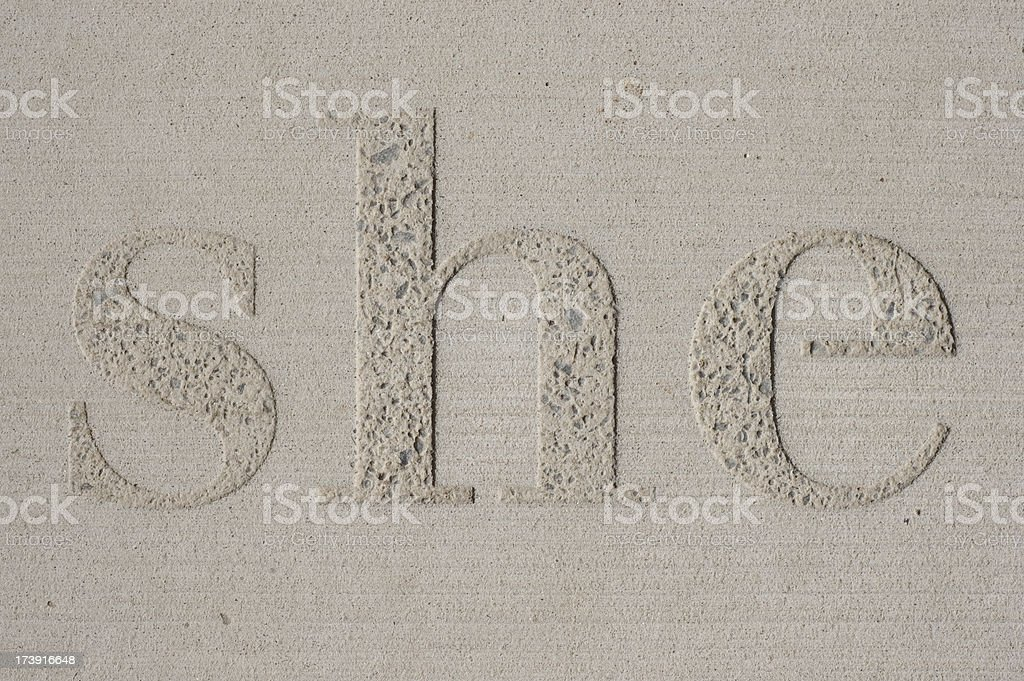 word 'she' embossed in cement royalty-free stock photo