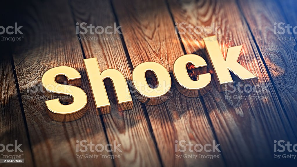 Word Shock on wood planks stock photo