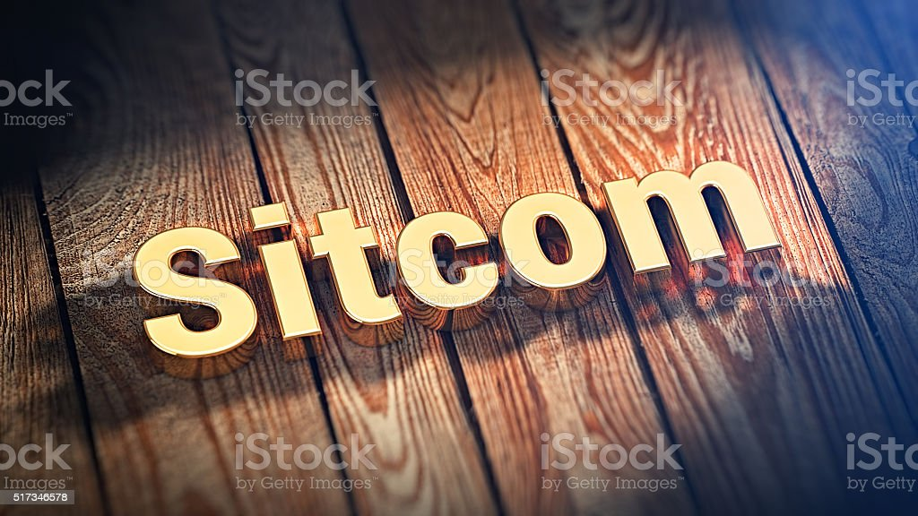 Word Sitcom on wood planks stock photo