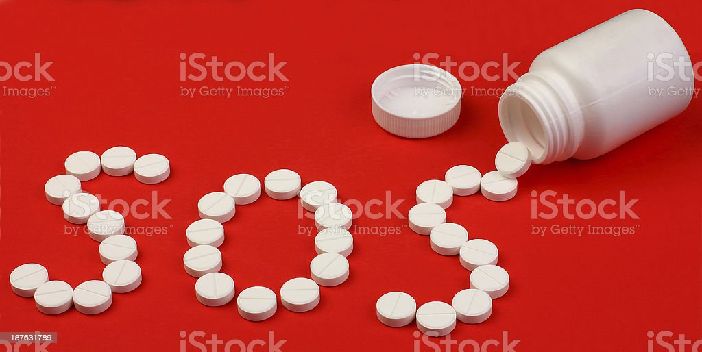 word SOS made of pills. royalty-free stock photo