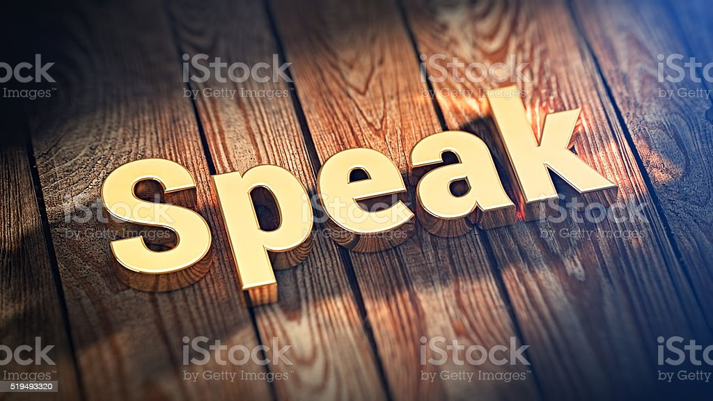 Word Speak on wood planks stock photo