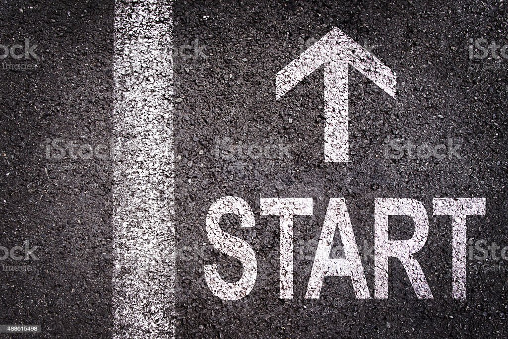 Word Start and an arrow written on  asphalt stock photo