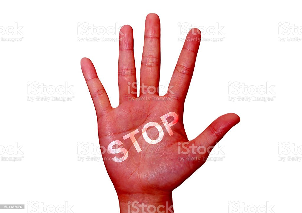 word stop on the red colored hand stock photo