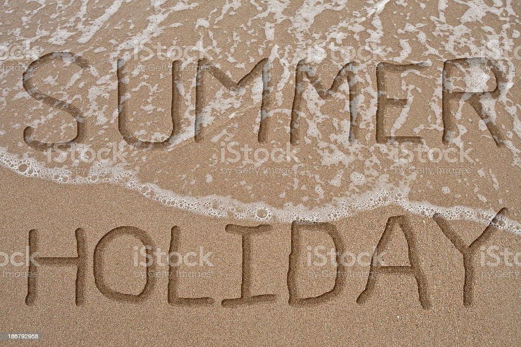 Word Summer holiday on wave and sand royalty-free stock photo