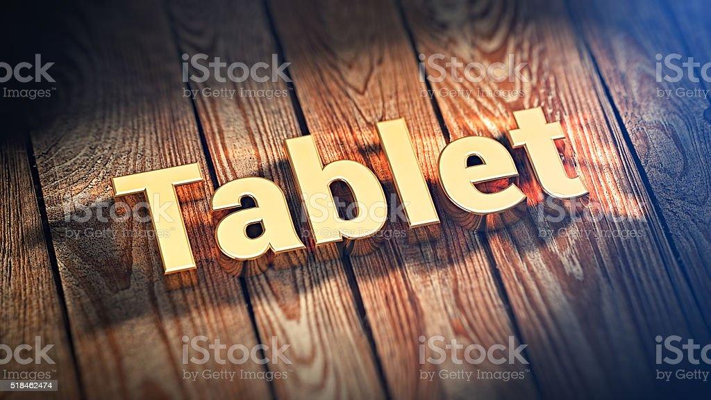 Word Tablet on wood planks stock photo