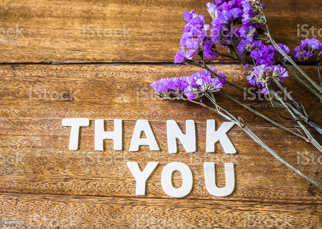 Word Thank you on wooden table stock photo