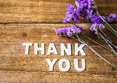 Word Thank you on wooden table