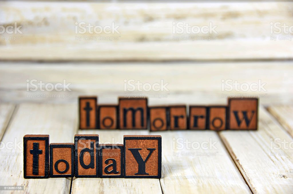 word today and tomorrow in letterpress type stock photo