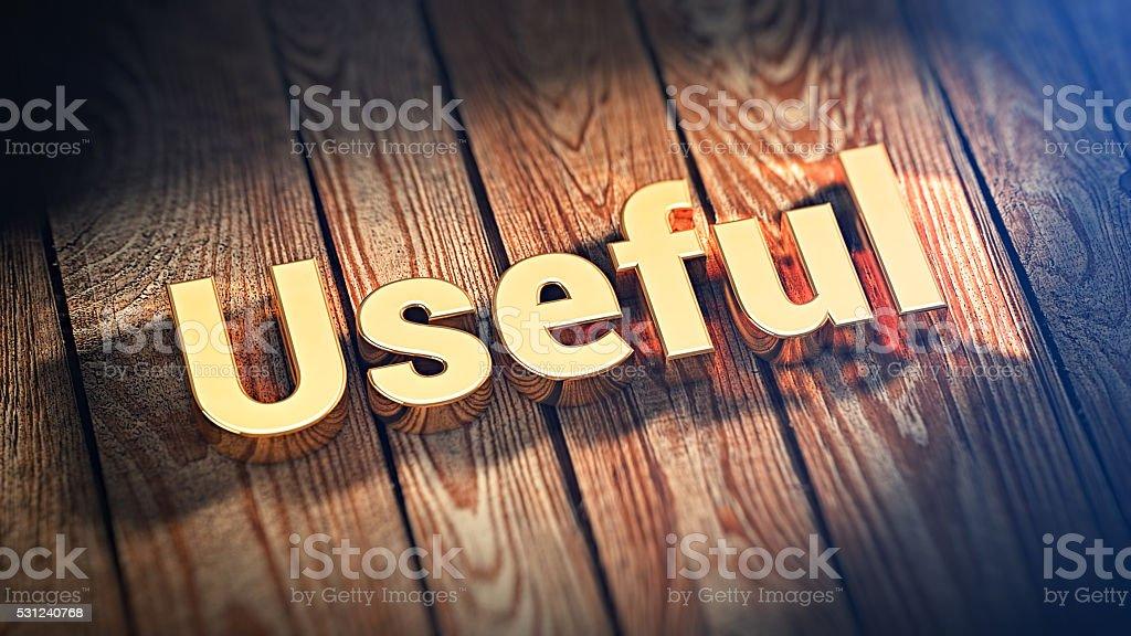 Word Useful on wood planks stock photo