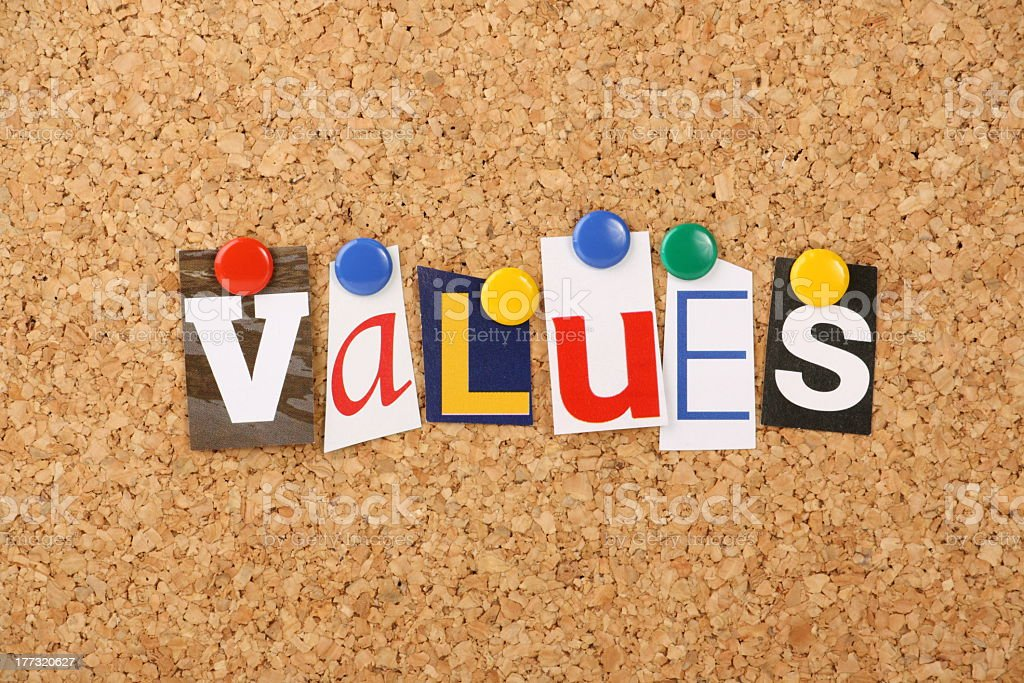 Word values thumb-tacked to cork board royalty-free stock photo