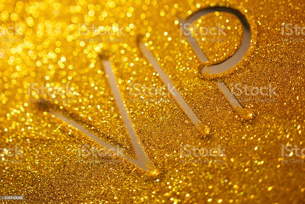word  vip writing on golden sand background stock photo