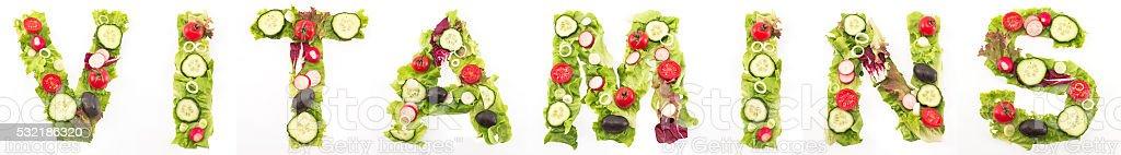 Word vitamins made of salad stock photo