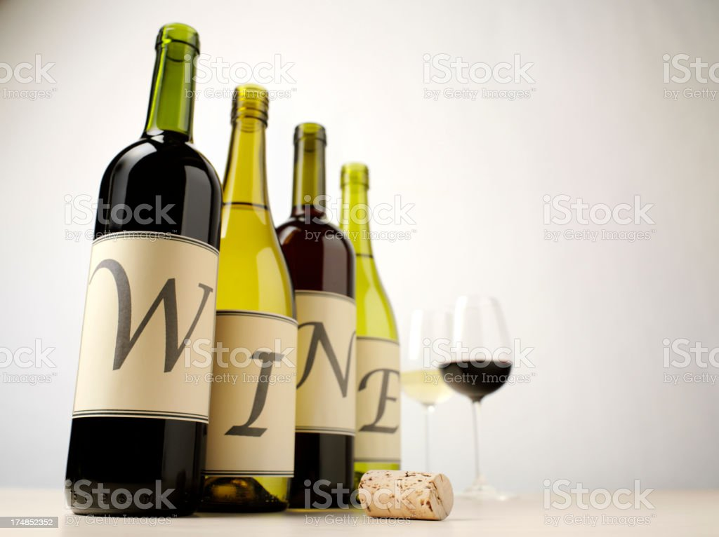 Word Wine on Bottles with Glasses of Red and White royalty-free stock photo