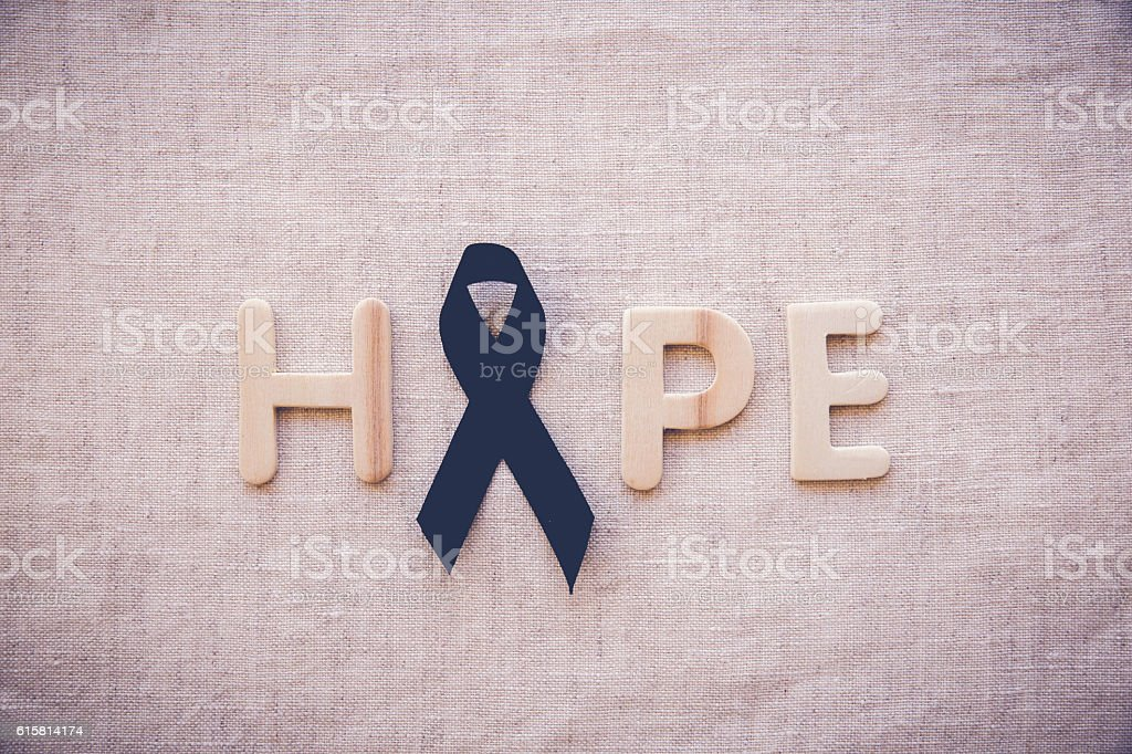 HOPE word with black ribbon, for Skin cancer awareness, Melanoma stock photo
