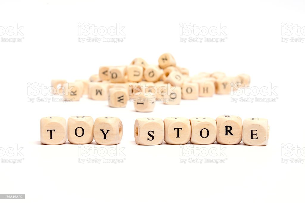 word with dice on white background- toy store stock photo