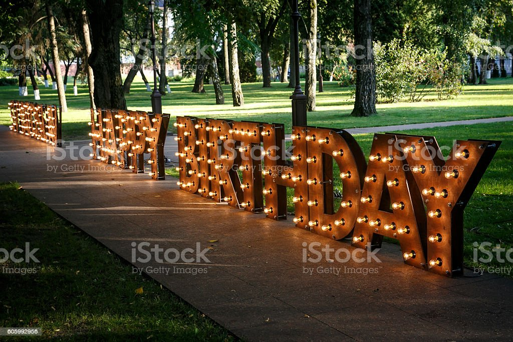 HAPPY BIRTHDAY word with glowing light bulbs stock photo