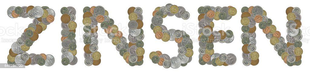 ZINSEN word with old coins stock photo