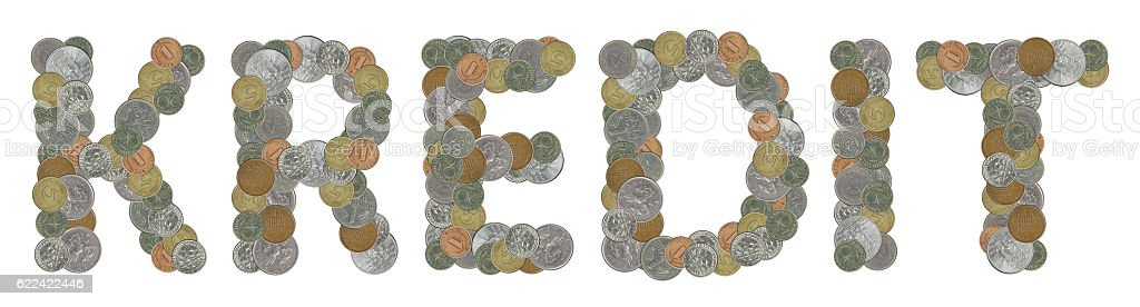 KREDIT word with old coins stock photo