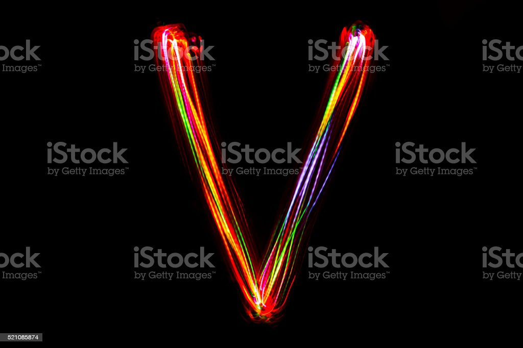 Word writing from light on the black background. stock photo