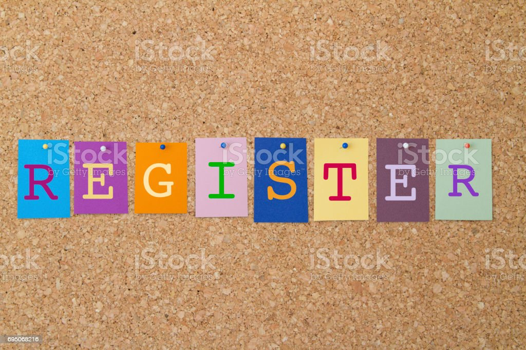 REGISTER word written on colorful sticky notes pinned on cork board. stock photo
