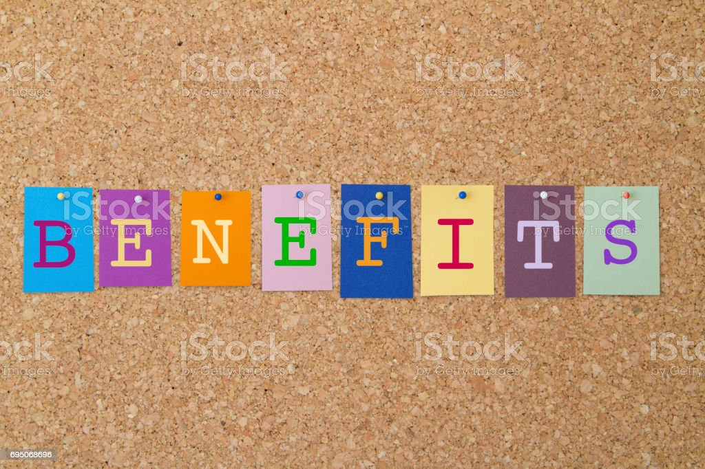 BENEFITS word written on colorful sticky notes pinned on cork board. stock photo