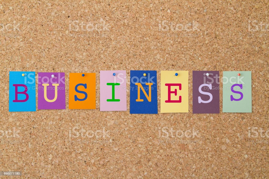 BUSINESS word written on colorful sticky notes pinned on cork board. stock photo