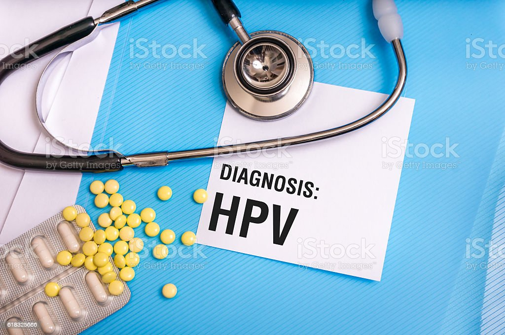 HPV word written on medical blue folder with patient files stock photo