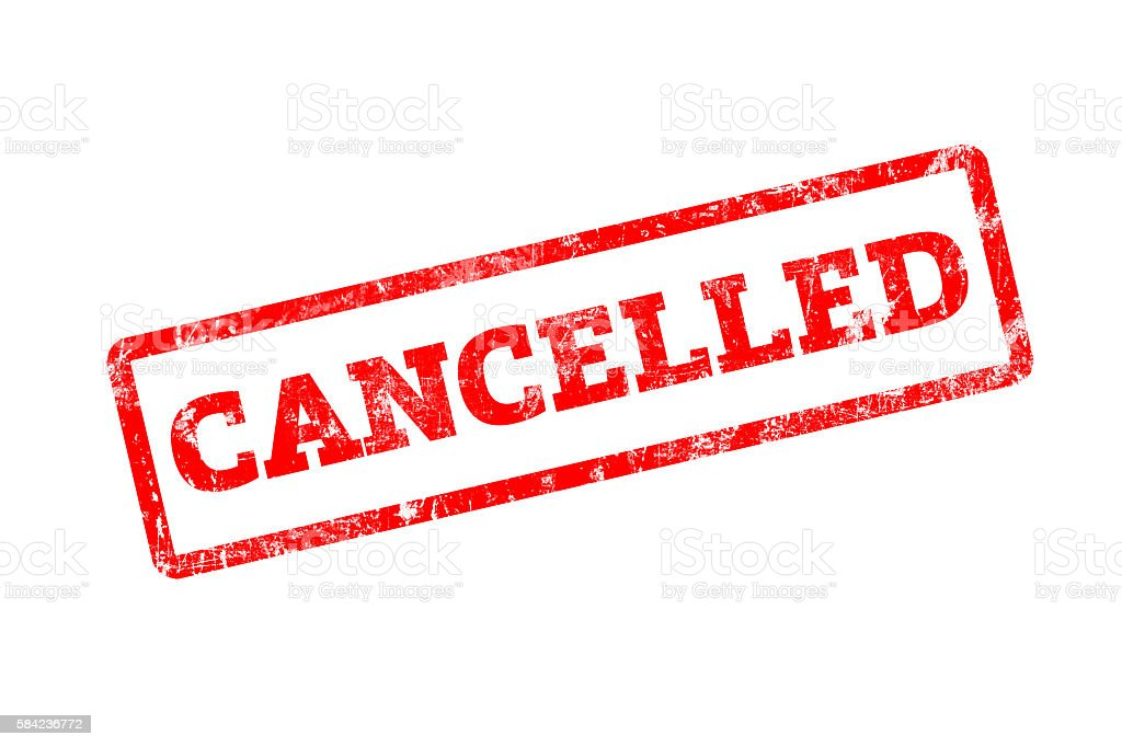 CANCELLED word written on red rubber stamp stock photo