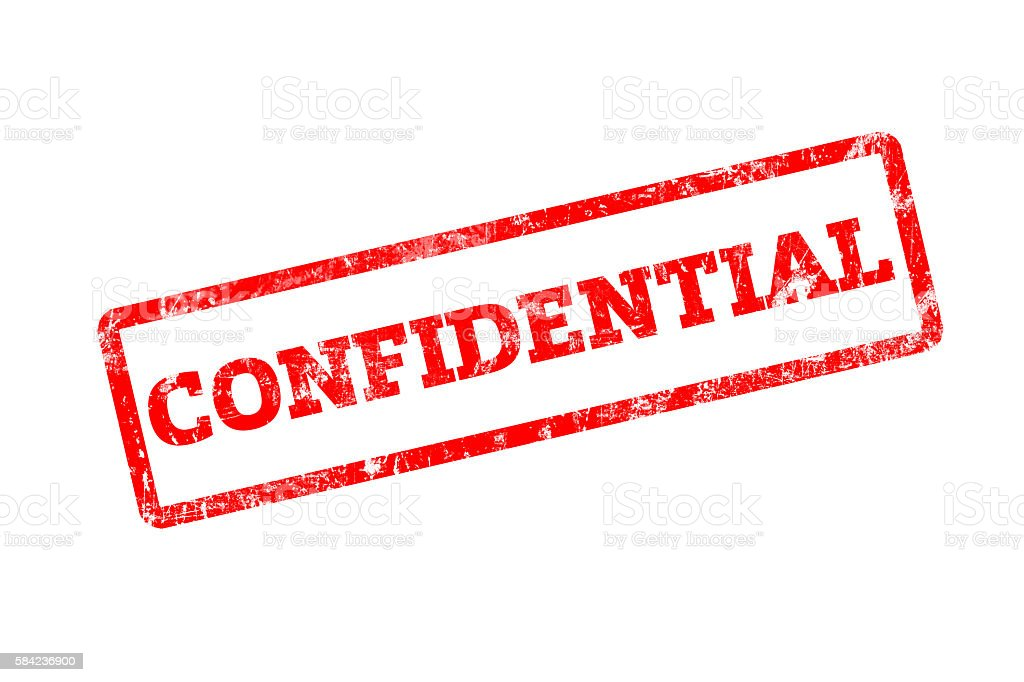 CONFIDENTIAL word written on red rubber stamp with grunge edges. stock photo