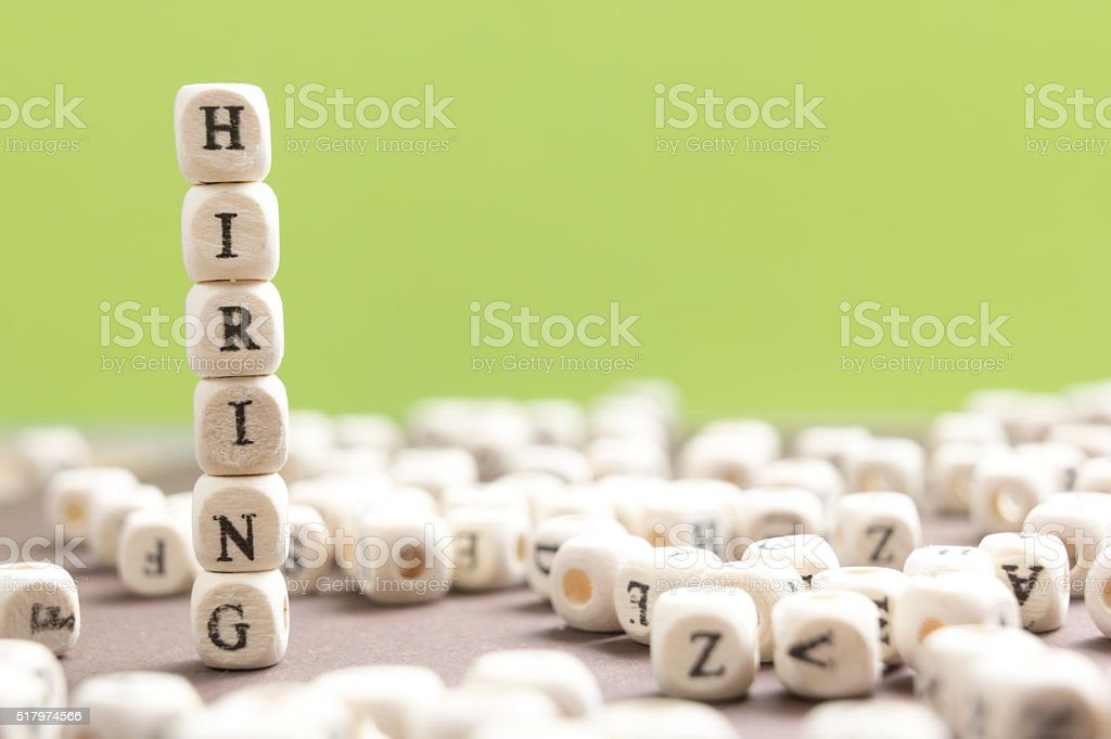 HIRING word written on wood block. Wooden Abc stock photo
