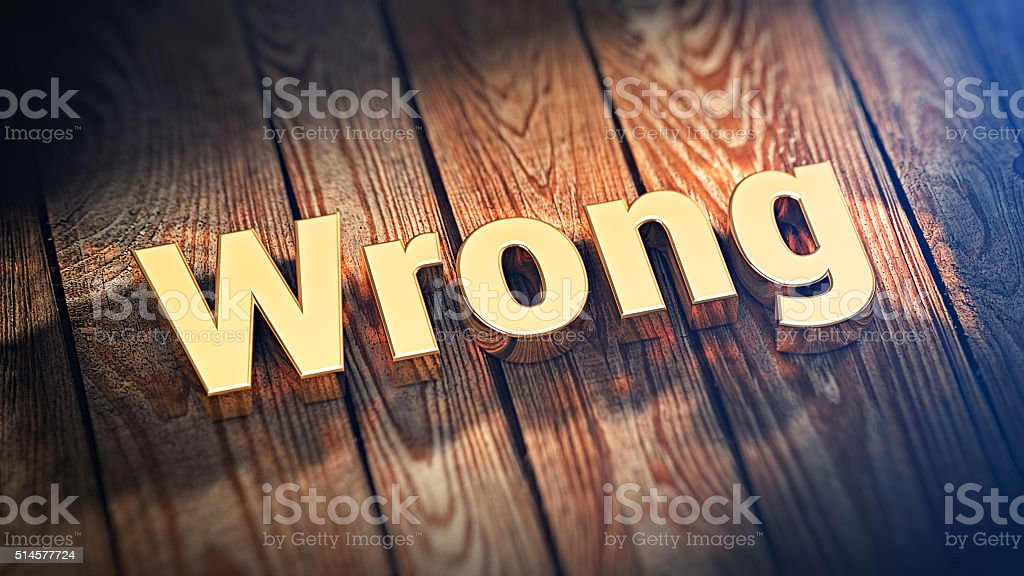 Word Wrong on wood planks stock photo