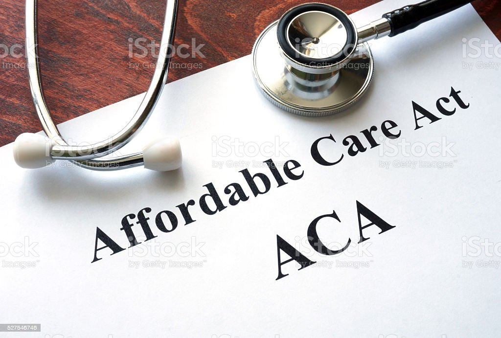 Words Affordable Care Act  ACA written on a paper. stock photo