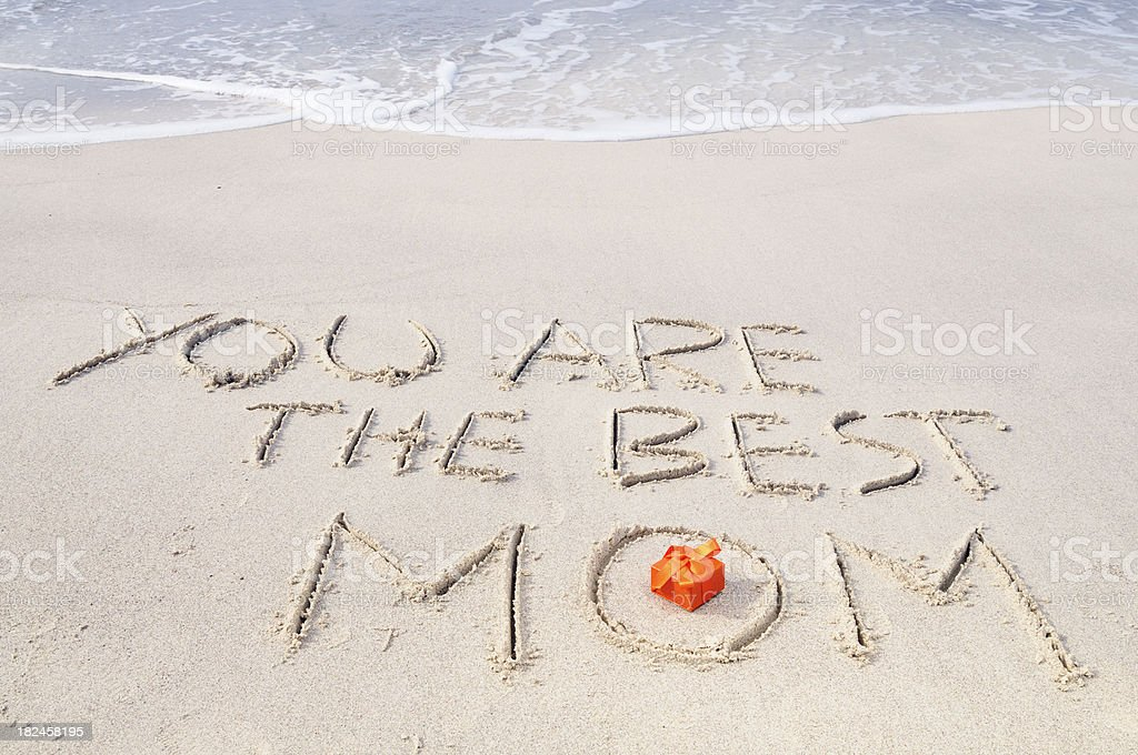 Words and Gift in the Sand on Mother's Day royalty-free stock photo