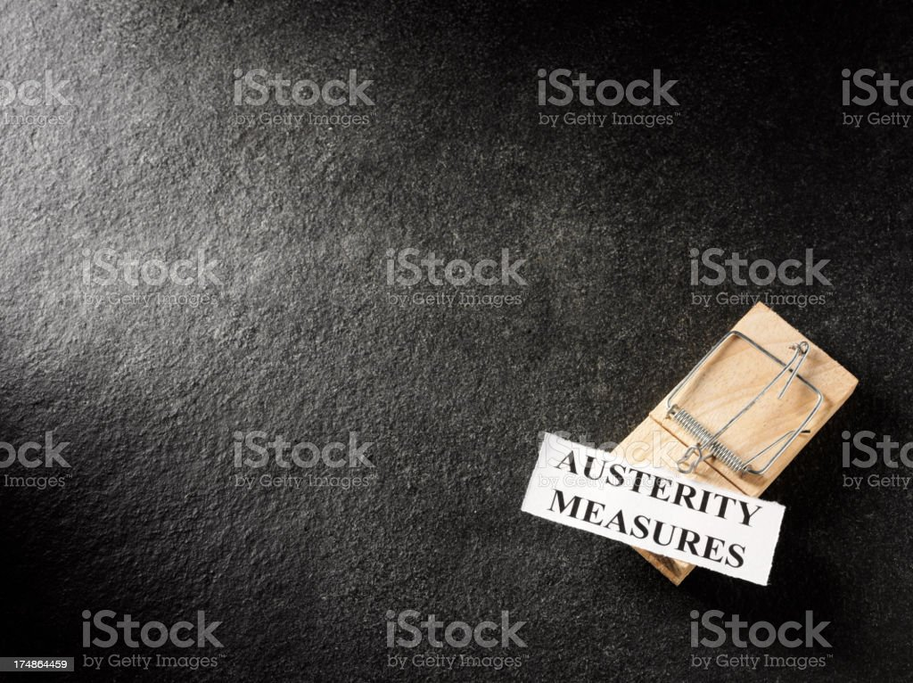 Words Austerity Measures on a Slate Background royalty-free stock photo