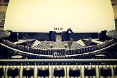 Words 'begin' written with old typewriter