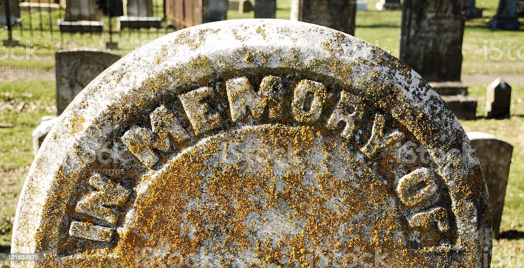 Words In Memory Of on ancient grungy tombstone royalty-free stock photo
