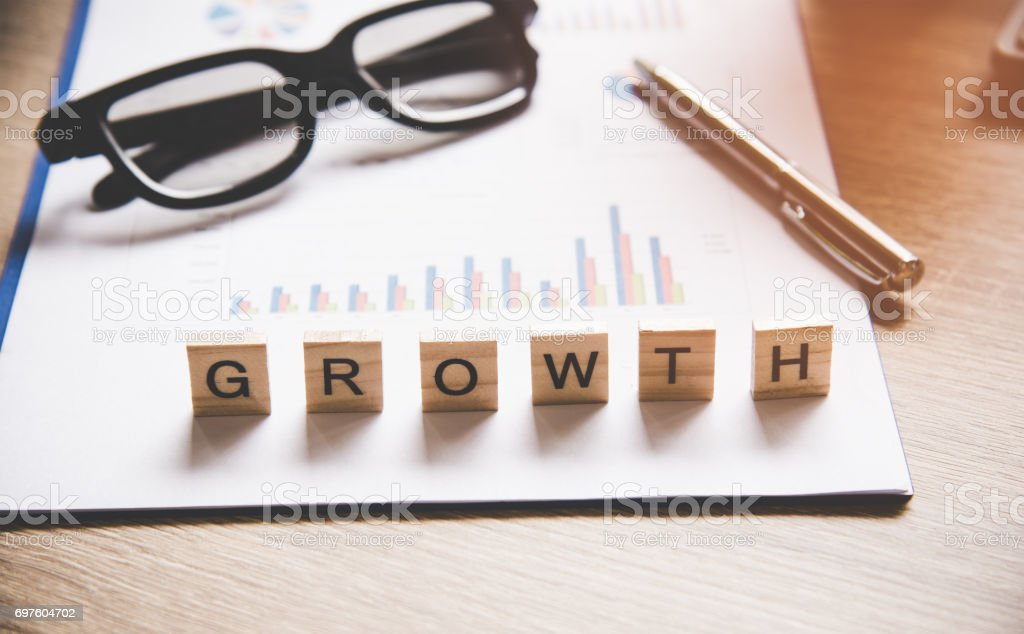 Words of business concepts collected in crossword with wooden cubes stock photo